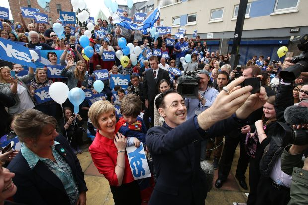 Cumming, a supporter of Scottish independence, takes a selfie with Nicola Sturgeon while campaigning in Glasgow in 2014. Photograph: Jeremy Sutton-Hibbert/Getty Images