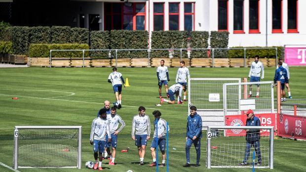 Bayern Munich players train on Wednesday. The Bundesliga can restart in the second half of May following the coronavirus stoppage, Chancellor Angela Merkel said on Wednesday. Photograph: Lukas Barth-Tuttas/EPA