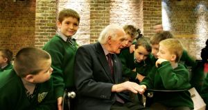 John Gallagher talks with students from Francis Street  school in 2007. He was chairman of the board of management there for years. File photograph: Kate Geraghty.