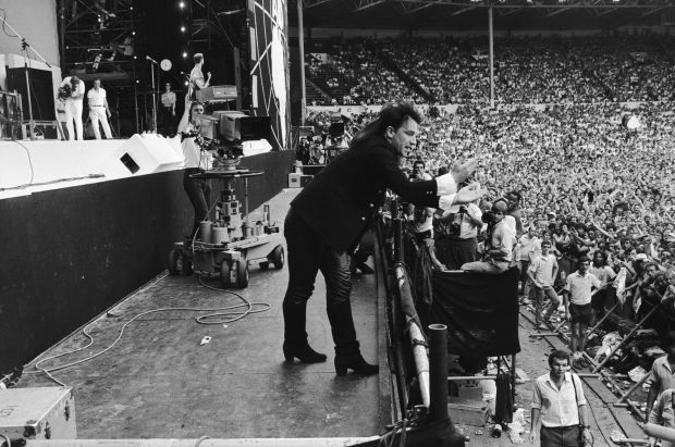 Live Aid: Bono performing in Wembley stadium in July 1985. Photograph: Hulton Archive/Getty