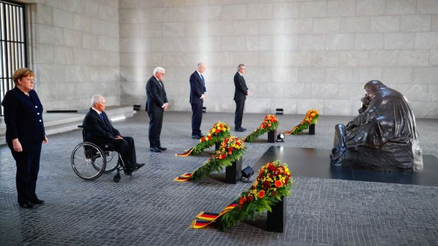 German chancellor Angela Merkel, the president of the Bundestag Wolfgang Schaeuble, German president Frank-Walter Steinmeier, the current president of the Bundesrat and Brandenburg's state premier Dietmar Woidke and Andreas Vosskuhle, President of Germany's Constitutional Court, attend a wreath laying ceremony to mark the 75th anniversary of the end of World War Two, at the Neue Wache Memorial in Berlin, Germany. Photograph: Hannibal Hanschke/Pool/AFP via Getty Images