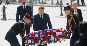 French President Emmanuel Macron lays a wreath of flowers for VE day at the Arc de Triomphe in Paris. Photograph: Charles Platiau/AFP via Getty Images
