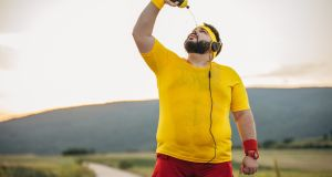"""If you're wearing earphones the size of deer antlers, presumably all you can hear is the theme from Chariots of Fire, or Rocky, or whatever else is on that personally curated motivational soundtrack of the movie starring you."" Photograph: Getty Images"