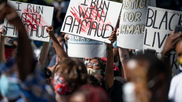 Demonstrators protest at the shooting dead of Ahmaud Arbery at the Glynn County courthouse in Brunswick, Georgia in May. Photograph: Sean Rayford/Getty Images