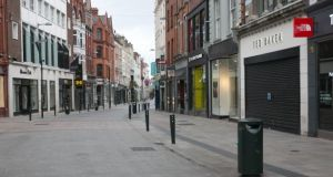 A deserted Grafton Street during the coronavirus lockdown. Photograph: Gareth Chaney/Collins
