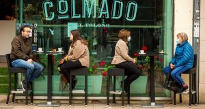 People enjoy breakfast sat outside a cafe in Vitoria in the Basque Country. Photograph: David Aguilar/EPA