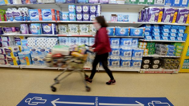 Tesco shoppers are reminded to keep two metres apart in what business strategy company the Board of Innovation calls 'the low touch economy'. Photograph: Alan Betson/The Irish Times
