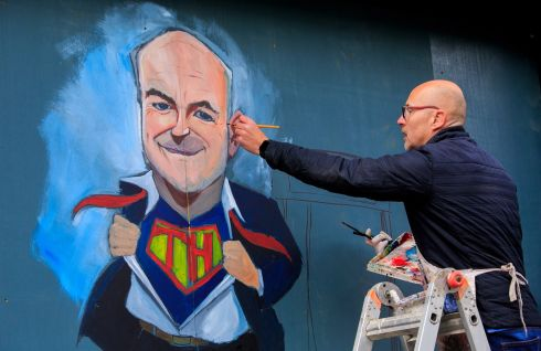 SUPER TONY: Artist Niall O'Loughlin paints a mural to Chief Medical Officer Tony Holohan at Devitts Pub on Camden Street, Dublin. Photograph: Gareth Chaney/Collins