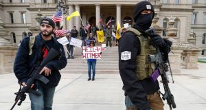 Anti-lockdown protesters  near the steps of the Michigan state capitol building in Lansing last month. Photograph: Paul Sancya/AP