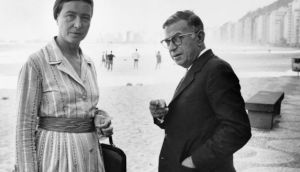 Existentialist philosophers Simone de Beauvoir and Jean-Paul Sartre enjoy the freedom of the beach in Rio in 1960. Photograph: STF/AFP/Getty