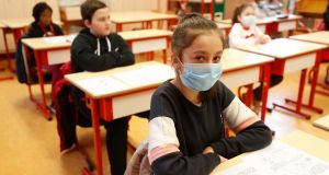 Schoolchildren, some wearing masks, attend a class in a school of Strasbourg,  France on Thursday. Photograph:Jean-Francois Badias/AP