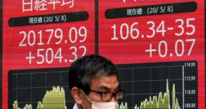 The sudden drop in markets as the Covid-19 crisis unfolded prompted some people to move their money from cash deposits to investment options that might, just might, yield better returns. Photograph:  EPA/ Kimimasa Mayama