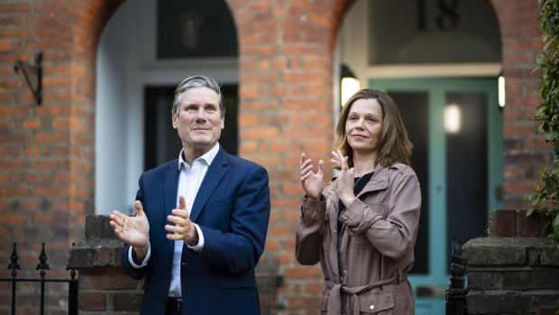 Irish backstop - Labour leader Sir Keir Starmer and his wife Victoria applaud for key workers outside their hom in London. Starmer's net favourability rating passed the prime minister's this week. Photograph: Justin Setterfield/Getty Images