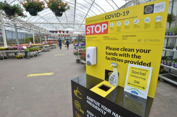 A Covid-19 sanitation station in Jones Garden Centre in Donabate. Photograph: Alan Betson/The Irish Times