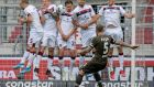 ONE FOR THE TEAM: St Pauli's Marvin Knoll hammers in a free kick during the German Bundesliga second division soccer match between FC St Pauli and 1 FC Nuremberg in Hamburg, Germany, after the resumption of the league behind closed doors as the coronavirus pandemic continues. Photograph: Axel Heimken/EPA