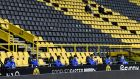 Schalke substitutes keep their distance during their side's 4-0 defeat to Borussia Dortmund. Photograph: Martin Meissner/EPA