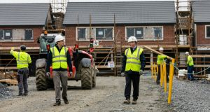 Glenveagh chief executive Stephen Garvey and Cathal Mooney, head of health and safety, at one of the company's sites that reopened on Monday. Photograph: Fennells