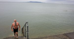 Jonathan Smith emerges from the water after his early morning swim in Blackrock.