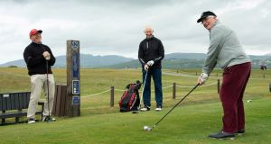 Three brothers, (from left) Bosco, Gerard and Charlie Kelly from Derry tee off on the 12th hole at  North West GC,  Lisfannon, Co Donegal. Photograph:  Joe Dunne