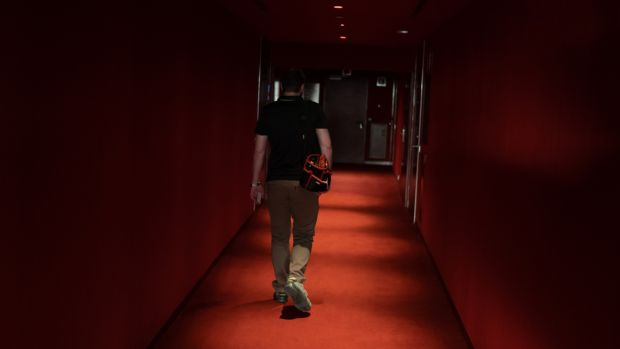 Daniel Ordoñez, who is in charge of maintenance of the W Hotel in Barcelona, walks through one of the hotel's halls. Photograph: Samuel Aranda/The New York Times