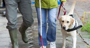 The NCBI says practicing or engaging in physical or social distancing is virtually impossible for people who are blind. Photograph: Getty Images
