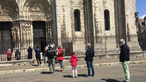Visitors queue at the reopened Notre Dame de Chartres cathedral on May 14th. Only 10 people were allowed in the cathedral at any one time. Photograph: Tala Skari