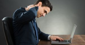 Assess your work set up, and strive for good posture if sitting at a computer. Photograph: iStock