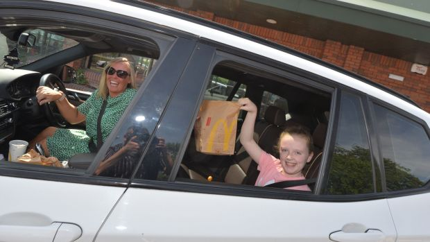 Edel Farrell and her daughter Layla (10) were among those to visit the McDonalds on the Kylemore Road. Photograph: Alan Betson/The Irish Times