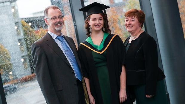 Fiona Boyle photographed on her graduation day with her parents.