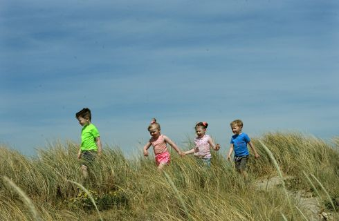 DOLLYMOUNT DUNES: Cody Byrne, Kacie Byrne, Ellie Walsh and Kai Kinsella playing in the sand dunes at Dollymount strand, Dublin. Photograph: Dara Mac Dónaill/The Irish Times
