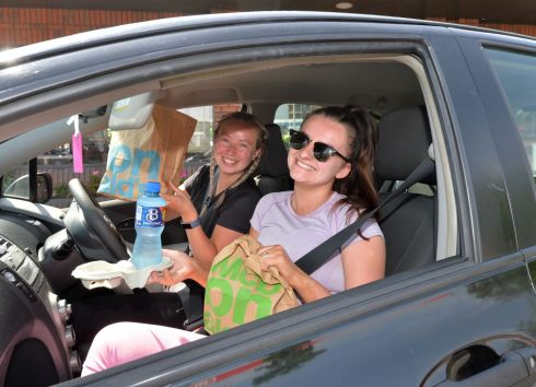 LOVING IT: Kelly Leahy and Aimee Bennett from Crumlin were among the first to secure their order when McDonald's reopened its drive-through service at Kylemore Road, Dublin. Photograph: Alan Betson/The Irish Times