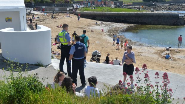 Gardaí check addresses of visitors to Sandycove after it and the Forty Foot reopened on Wednesday. Photograph: Alan Betson / The Irish Times