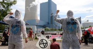 Demonstrators stage a protest against climate change at the coal-fired power plant in Datteln, Germany. Photograph: EPA/Friedemann Vogel