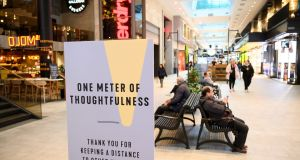 A picture taken earlier this month shows people keeping social distances at a shopping centre  in Stockholm. Photograph: Henrik Montgomery/ TT news agency/ AFP via Getty Images