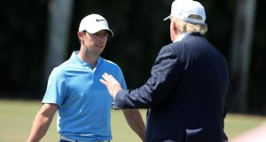 Rory McIlroy talks to the then Republican presendential candidate Donald Trump  during the 2016 WGC-Cadillac Championship at Trump National Doral Blue Monster Course on March 6, 2016 in Doral, Florida. Photograph:  Mike Ehrmann/Getty Images