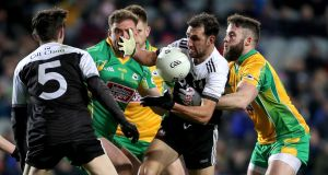 Kilcoo's Aidan Branagan is tackled by Conor Cunningham of Corofin during the All-Ireland club senior football final at Croke Park on January 19th. Photograph: Bryan Keane/Inpho