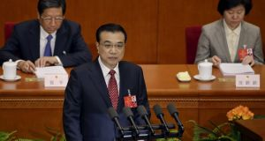 China's premier Li Keqiang gives a speech during the opening session of the National People's Congress.