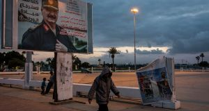 A billboard depicting General Khalifa Haftar, the commander of the Libyan National Army, in Benghazi. Photograph: Ivor Prickett/The New York Times