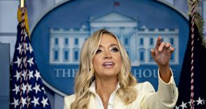 White House press secretary Kayleigh McEnany held up a document revealing Donald Trump's bank details. Photograph: Bloomberg