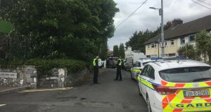 Gardaí at the scene of a fire at a house in Lansdowne Valley, Drimnagh. Photograph: Jack Power