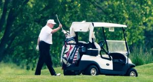 US president Donald Trump plays golf at the Trump National Golf Club in Sterling, Virginia on Saturday. It is the first time the president has played golf since the Covid-19 lockdown. Photograph: Jim Lo Scalzo/EPA