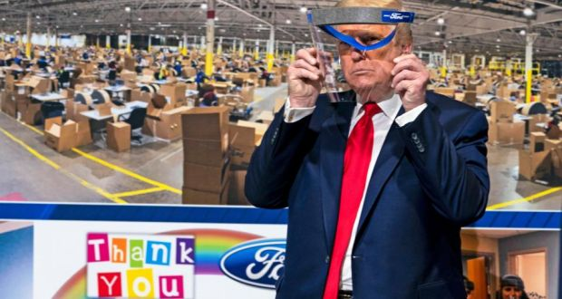 US president Donald Trump displays a face shield made at Ford's Rawsonville Plant in Ypsilanti, Michigan on May 21st. Photograph: Doug Mills/The New York Times