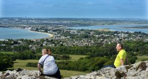 PERFECT VISTA: Susan and Michael Creedon, from Coolock, Dublin, sit and enjoy the views over the north city area while out for a walk around Deer Park, Howth. Photograph: Dara MacDónaill