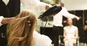 Hair salons: Face coverings for staff and clients will be mandatory, while customers would be seen by appointment only. Photograph: iStock