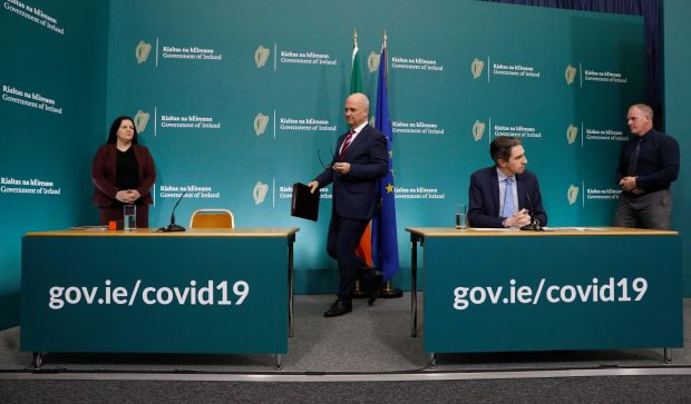 Bernadette Ferguson (left) and Michael Feeney (far right), along with chief medical officer Dr Tony Holohan and Minister for Health Simon Harris at the Government Buildings Press Centre in Dublin. Photograph: Leon Farrell/Photocall Ireland/PA