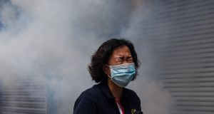A woman reacts after riot police fired tear gas to disperse protesters taking part in a pro-democracy rally against a proposed new security law in Hong Kong on Sunday. Photograph: AFP