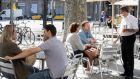 People sit on the terrace of a bar in Barcelona, Spain, the government begins to further ease coronavirus restrictions. Photograph: Marta Perez/EPA