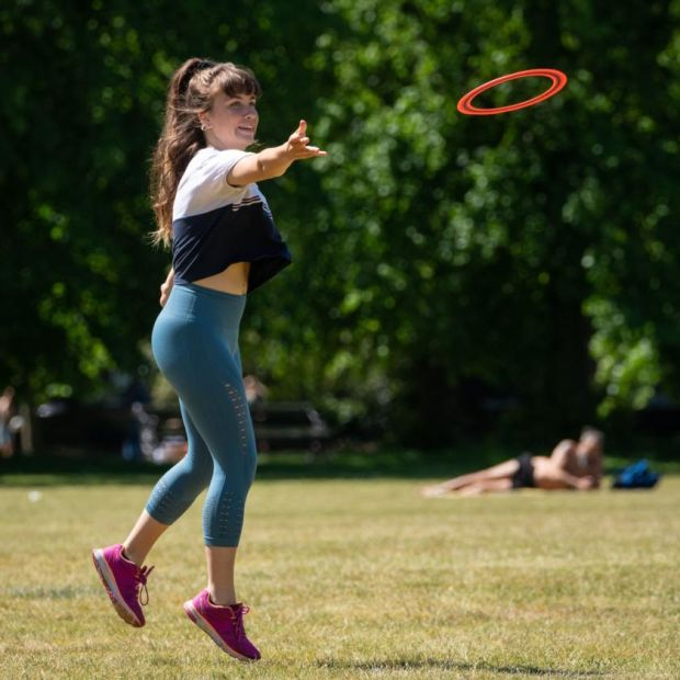 Frisbee: socially distant but still interactive, it might just be the perfect outdoor activity for the regulation four people. Photograph: Dominic Lipinski/PA Wire