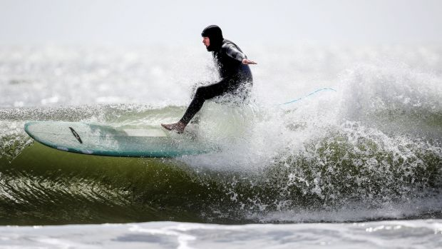 There have been opportunities to take different types of photos such as this one of surfers on Ballymoney Beach last week. Photo: Dan Sheridan/Inpho