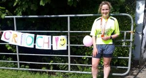 Áine Scanlon celebrates her first marathon at a very different finish line than she had imagined when she set out training last winter. Instead of running with thousands of other runners she ran solo on the quiet roads local beside her family home in Kerry